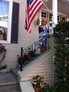 Anne standing on the steps of the house which belonged to the lawyer for Marjorie Kinnan Rawlings